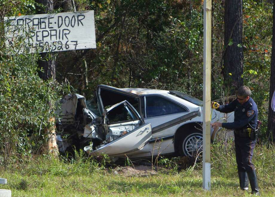 Authorities investigate a traffic crash Friday on Beltway 8 near Tidwell. One person died when a white Buick slammed into trees on the frontage road, police said. It was unclear what caused the crash. Photo: Cody Duty, Staff / © 2014 Houston Chronicle