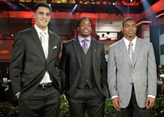 Heisman Trophy candidates, from left, Oregon's Marcus Mariota, Wisconsin's Melvin Gordon and Alabama's Amari Cooper pose for a photo at the College Football Awards, Thursday, Dec. 11, 2014, in Lake Buena Vista, Fla. The winner of the Heisman Trophy will be announced on Saturday. (AP Photo/John Raoux) ORG XMIT: FLJR126 Photo: John Raoux / AP