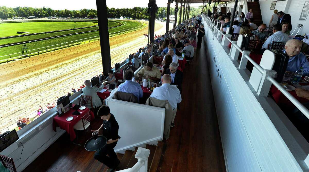 The Turf Terrace is full, July 29, 2013, at Saratoga Race Course in Saratoga Springs, N.Y. Racing fans who want to dine at Saratoga Race Course?s three main restaurants will have to pay for their seats ahead of time starting next summer. (Skip Dickstein/Times Union)