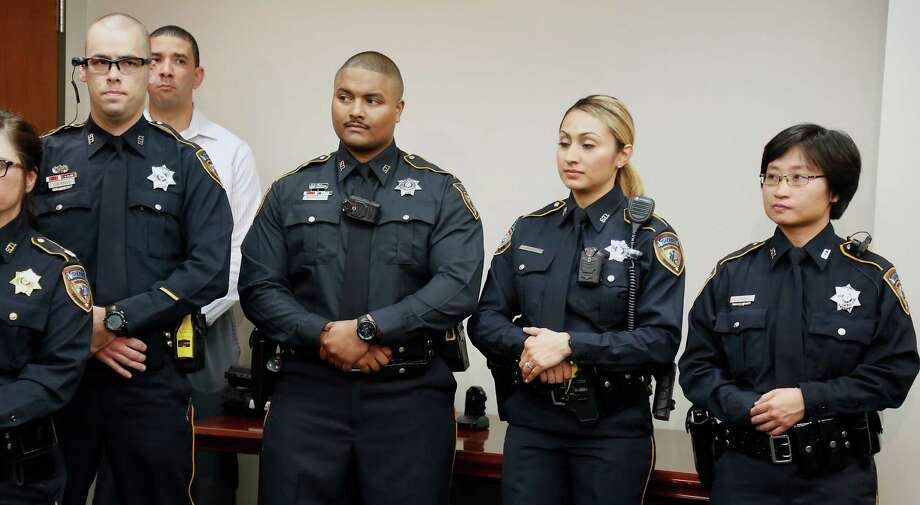 Deputies wear the various types of body cameras, including, from left, those attached to eyeglasses, on the chest and on the shoulder, during a news conference Friday. Photo: James Nielsen, Staff / © 2014  Houston Chronicle