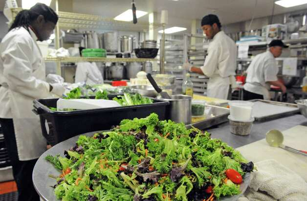 The kitchen team gets food prepared for a holiday Part at the Mazzone Hospitality catering kitchen on Friday, Dec. 12, 2014, in Clifton Park , N.Y.  (Michael P. Farrell/Times Union) Photo: Michael P. Farrell / 00029833A