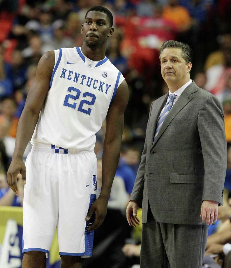 FILE - In this March 15, 2014, file photo, Kentucky head coach John Calipari and forward Alex Poythress (22) watch play against Georgia during the second half of an NCAA college basketball game in the semifinal round of the Southeastern Conference men's tournament in Atlanta. Poythress will miss the rest of the season after tearing a knee ligament during practice the school said Thursday, Dec. 11, 2014.  (AP Photo/Steve Helber, File) Photo: Steve Helber, STF / AP