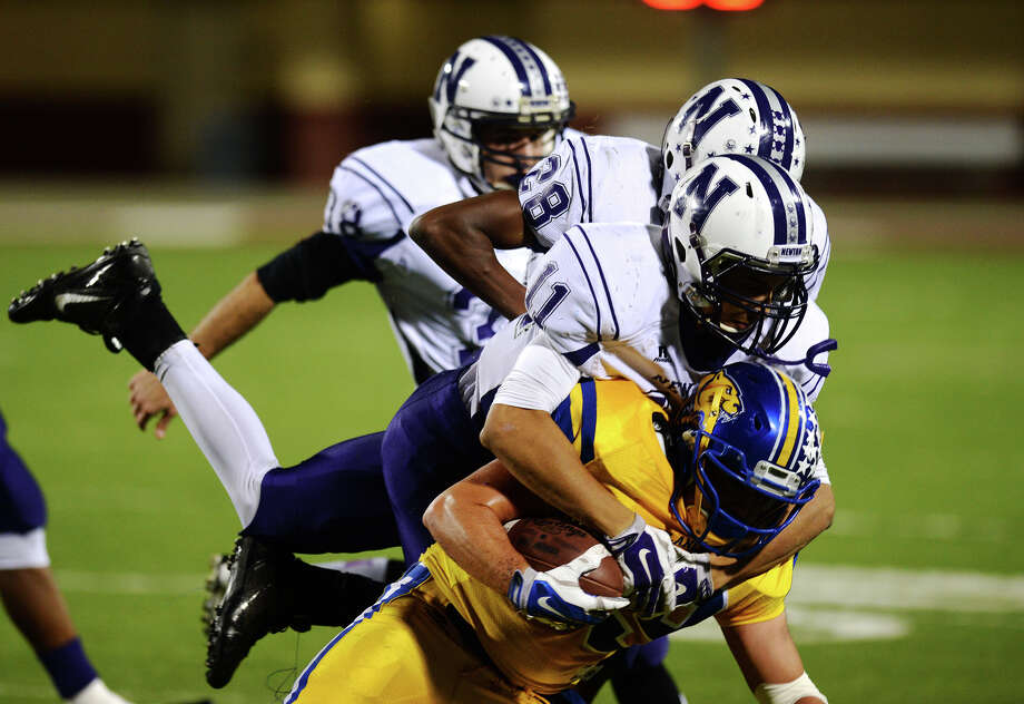 Blanco's Carson Kipp, No. 19, is tackled by Newton's Kirkland Foster, No. 11, during Friday night's game. The Newton Eagles faced off against the Blanco Panthers in the Class 3A Division II state semifinals at Waller ISD Stadim on Friday night. Photo taken Friday 12/12/14 Jake Daniels/The Enterprise Photo: Jake Daniels / ©2014 The Beaumont Enterprise/Jake Daniels