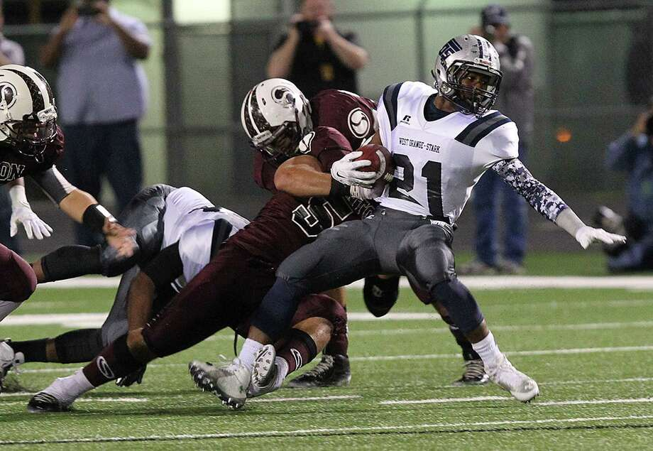 Todd Yates/Caller-TimesWest Orange-Stark Mustangs Jeremiah Shaw gains a fist down against the Sinton Pirates during the first quarter of Friday's Class 4A division II semifinal game Traylor Stadium in Rosenberg. Photo: ToddYates/Caller-Times