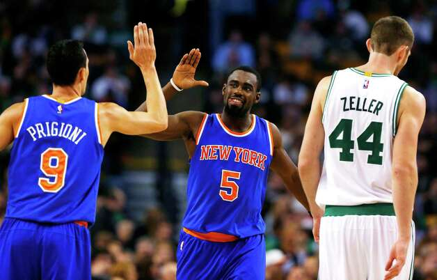 Tim Hardaway, Jr. (5) is congratulated by teammate Rajon Rondo (9) as Boston Celtics' Tyler Zeller walks to the bench during the second half of the New York Knicks 101-95 win in an NBA basketball game in Boston Friday, Dec. 12, 2014. (AP Photo/Winslow Townson) ORG XMIT: BXG114 Photo: Winslow Townson / FR170221 AP