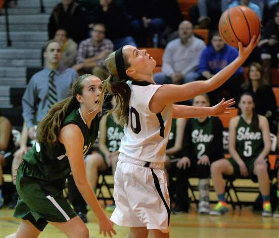 Bethlehem's #30 Emily Wander, right, gets past Shen's #32 Carly Boland on her way to the basket during Friday's game at Bethlehem High Dec. 12, 2014, in Delmar, NY.   (John Carl D'Annibale / Times Union) Photo: John Carl D'Annibale / 00029807A