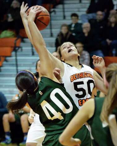 Bethlehem's #50 Erin O'Donnell, right, and Shen's #40 Victoria Pardi fight for a rebound during Friday's game at Bethlehem High Dec. 12, 2014, in Delmar, NY. (John Carl D'Annibale / Times Union) Photo: John Carl D'Annibale / 00029807A