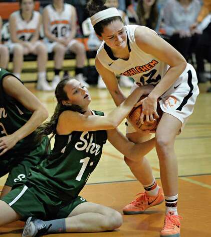 Shen's #11 Morgan O'Brien, left, and Bethlehem's #12 Jenna Giacone fight for a loose ball during Friday's game Dec. 12, 2014, in Delmar, NY. (John Carl D'Annibale / Times Union) Photo: John Carl D'Annibale / 00029807A
