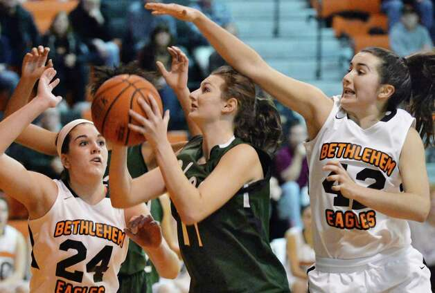 Shen's #11 Morgan O'Brien, center, fights to get off a shot between Bethlehem's #24 Gabby Giacone, left, and #42 Kylie McKenna during Friday's game Dec. 12, 2014, in Delmar, NY. (John Carl D'Annibale / Times Union) Photo: John Carl D'Annibale / 00029807A