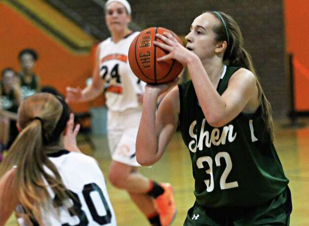 Shen's #32 Carly Boland, right, takes a shot during Friday's game against Bethlehem High Dec. 12, 2014, in Delmar, NY.  (John Carl D'Annibale / Times Union) Photo: John Carl D'Annibale / 00029807A
