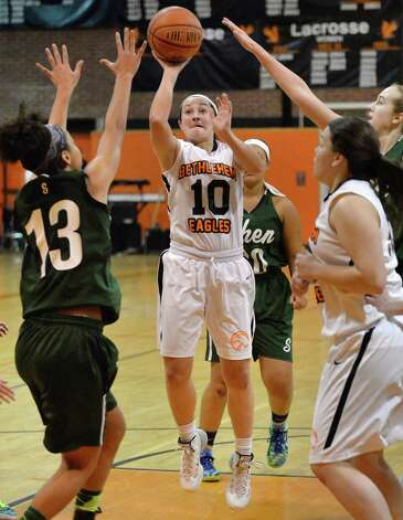 Bethlehem's #10, center, Kaylee Rickert shoots during Friday's game against Shenendehowa High Dec. 12, 2014, in Delmar, NY. (John Carl D'Annibale / Times Union) Photo: John Carl D'Annibale / 00029807A