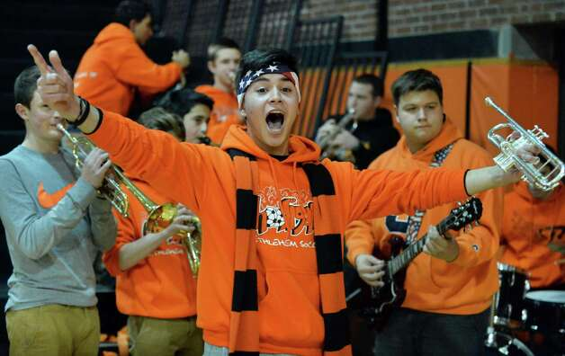 Bethlehem pep band trympeter Lucas Martinez cheers his team during Friday's game against Shenendehowa High Dec. 12, 2014, in Delmar, NY.  (John Carl D'Annibale / Times Union) Photo: John Carl D'Annibale / 00029807A