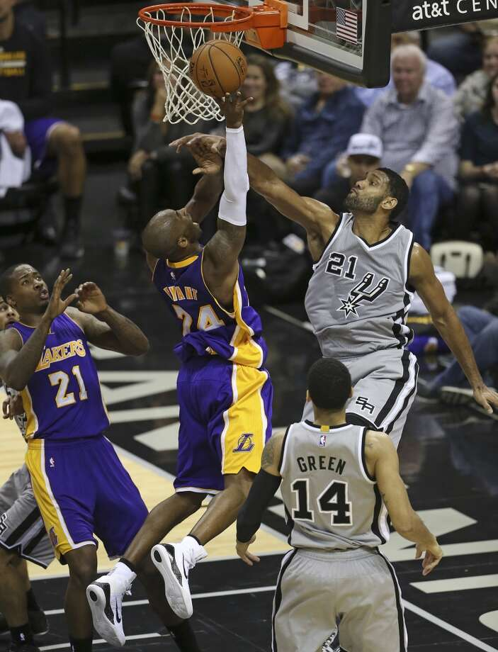 Kobe Bryant challenges Tim Duncan in the lane at the Spurs game against the Lakers at the AT&T Center on December 12, 2014.
