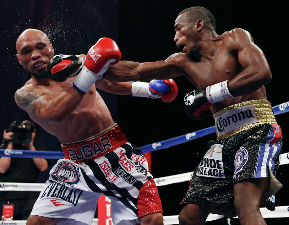 Ishe Smith (left) is hit by Erislandy Lara during their WBA super welterweight title bout Friday Dec. 12, 2014 at the Alamodome's Illusions Theater. Lara won by a unanimous decision. Photo: Edward A. Ornelas, San Antonio Express-News / © 2014 San Antonio Express-News