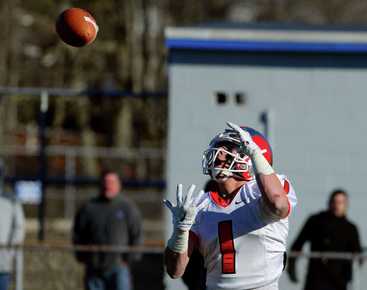 New Canaan's Alexander LaPolice receives a pass in the endzone to score the game tying touchdown, during Class L State Championship football action against Darien in West Haven, Conn., on Saturday Dec. 13, 2014. New Canaan went on to beat Darien 21-20.