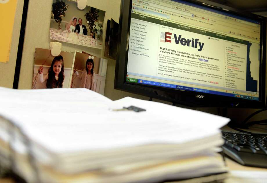 Gov. Rick Perry has issued an executive order requiring state agencies and contractors to use the E-Verify system, a federal electronic system used to weed out workers who are in the country illegally. Photo: Autumn Driscoll, Staff Photographer / Connecticut Post