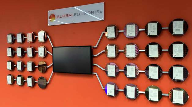 A wall of employee patents in the shape of a circuit hangs on the wall Global Foundries Friday morning Dec. 12, 2014 in Malta, N.Y.     (Skip Dickstein/Times Union) Photo: SKIP DICKSTEIN / 00029826A