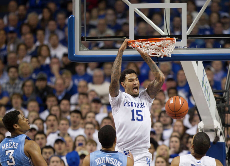 Kentucky's Willie Cauley-Stein dunks over North Carolina's Brice Johnson (11) and Kennedy Meeks (3) at Rupp Arena. Kentucky rolled to an 84-70 victory. Photo: Robert Willett / McClatchy-Tribune News Service / Raleigh News & Observer