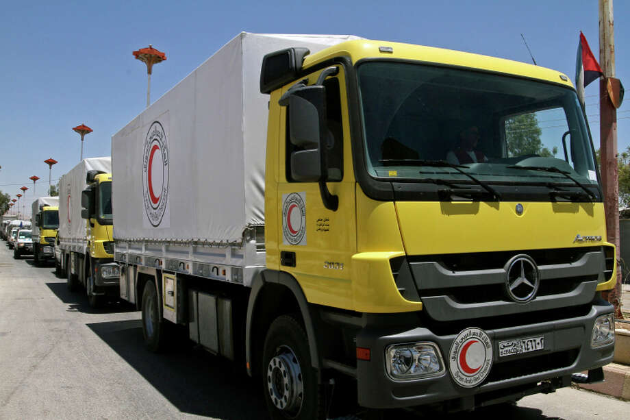 Syrian Red Crescent trucks haul food after the July U.N. decision to move aid without official consent. Photo: Uncredited / Associated Press / AP
