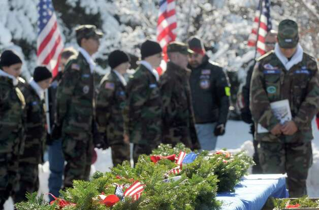 A ceremony for National Wreaths Across America Day was held at the Gerald Solomon National Cemetery on Saturday Dec. 13, 2014 in Schuylerville , N.Y.  (Michael P. Farrell/Times Union) Photo: Michael P. Farrell / 00029839A