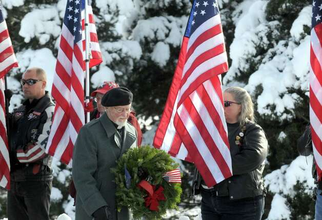 Rev. William G. Hempel of the Albany Maritime Minister lays a wreath for the United States Merchant Marines during a ceremony for National Wreaths Across America Day at the Gerald Solomon National Cemetery on Saturday Dec. 13, 2014 in Schuylerville , N.Y.  (Michael P. Farrell/Times Union) Photo: Michael P. Farrell / 00029839A
