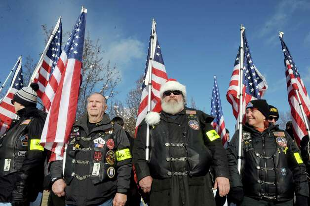Tim Bliss, center, of Scotia wears a Santa hat as he stand in formation with other Patriot Guards during a ceremony for National Wreaths Across America Day at the Gerald Solomon National Cemetery on Saturday Dec. 13, 2014 in Schuylerville , N.Y.  (Michael P. Farrell/Times Union) Photo: Michael P. Farrell / 00029839A