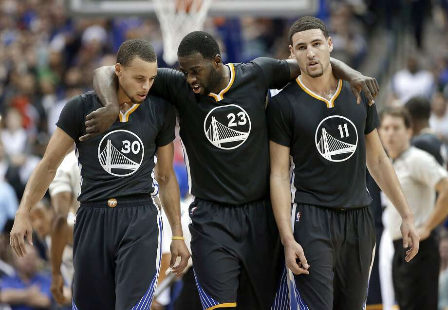 Golden State Warriors guard Stephen Curry (30), Draymond Green (23) and Klay Thompson (11) walk up court during the second half of an NBA basketball game against the Dallas Mavericks, Saturday, Dec. 13, 2014, in Dallas. Curry had 29-points, Green had 20-points and Thompson had 25-points in the 105-98 Warriors win. (AP Photo/Tony Gutierrez) Photo: Tony Gutierrez, Associated Press