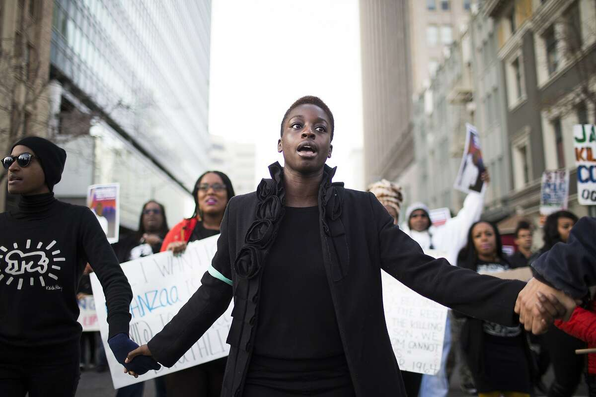 People march against racial injustice during a �