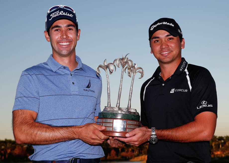Cameron Tringale (left) and Jason Day of Australia hold the Franklin Templeton Shootout hardware. Photo: Sam Greenwood / Getty Images / 2014 Getty Images