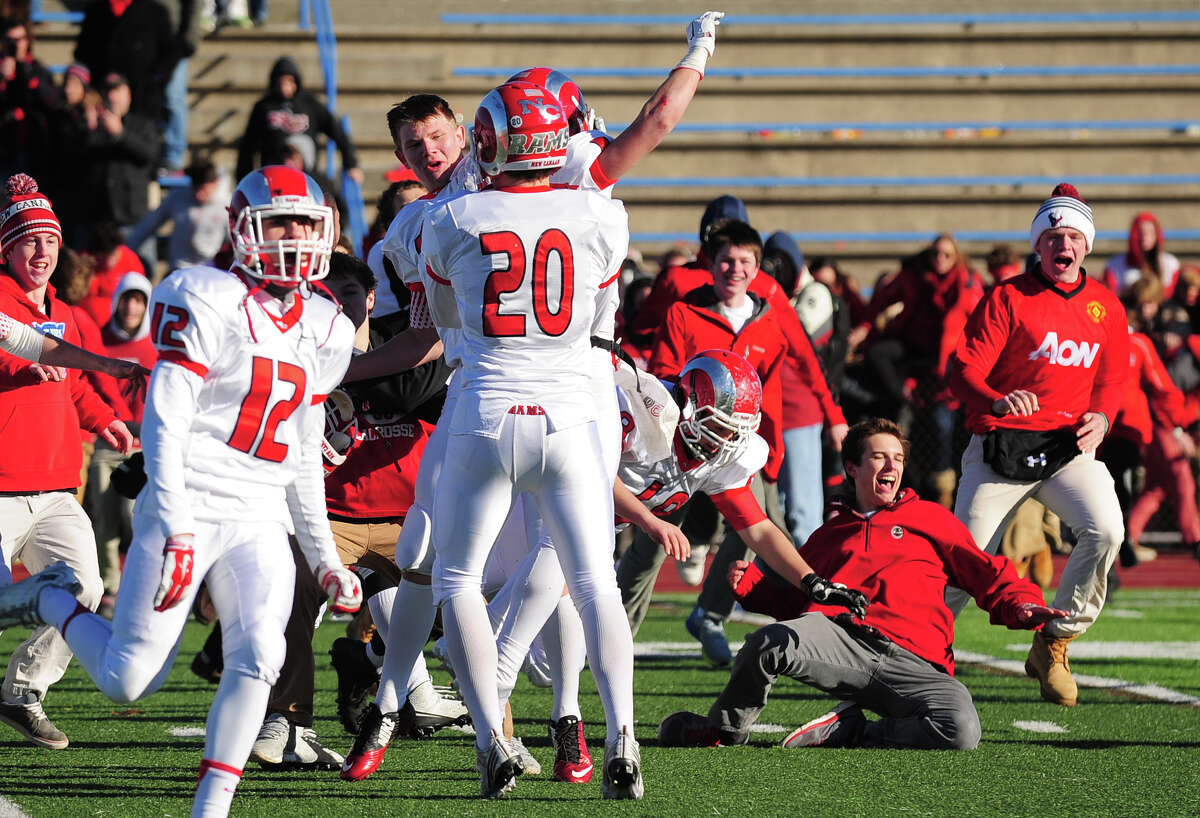 New Canaan celebrates its win over Darien, during Class L State Championship football action in West Haven, Conn., on Saturday Dec. 13, 2014. New Canaan beat Darien 21-20.