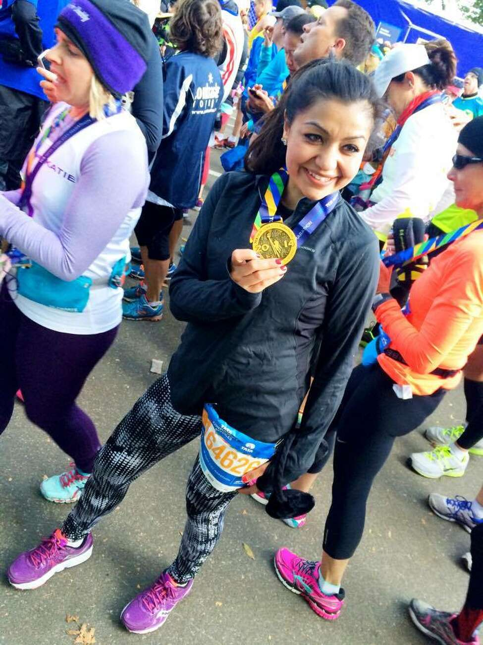 Sugam Langer, who started as a kid with 15-Love, shows her medal after completing the 2014 New York City Marathon. Langer is a graduate of Albany Academy for Girls and Siena College, where she played collegiate tennis, and now works as a lawyer at a consulting firm in New York City. She raised about $9,000 for 15-Love by finishing the marathon. (Photo courtesy of 15-Love)