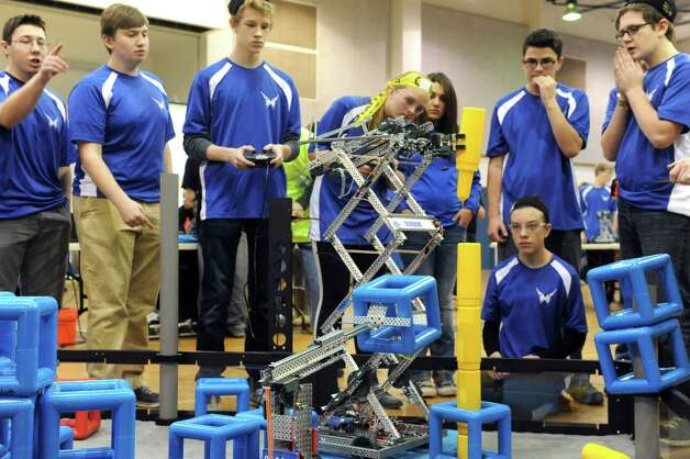 The Saratoga High School Blue Streak Robotic team competes during the Skyrise VEX Robotics Competition at Maple Avenue Middle School on Saturday Dec. 13, 2014 in Saratoga Springs , N.Y.  (Michael P. Farrell/Times Union) Photo: Michael P. Farrell / 00029837A