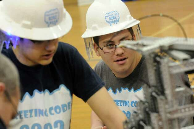Oswego High School students on the Freezing Code team Jordan Tryon and Mike Beckwith tweek their robot during the Skyrise VEX Robotics Competition at Maple Avenue Middle School on Saturday Dec. 13, 2014 in Saratoga Springs , N.Y.  (Michael P. Farrell/Times Union) Photo: Michael P. Farrell / 00029837A