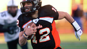 Shelton QB Mark Piccirillo carries the ball, during Class LL State Championship football action against Xavier in West Haven, Conn., on Saturday Dec. 13, 2014. Xavier beat Shelton 28-27.