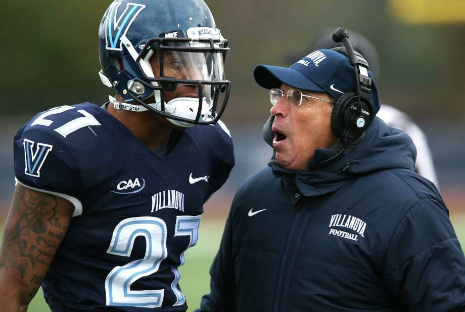 Villanova coach Andy Talley confers with defensive back Malik Reaves (27) in the first half of an FCS quarterfinal NCAA college football game against Sam Houston State, Saturday, Dec. 13, 2014, in Villanova. Sam Houston State won 34-31. (AP Photo/Laurence Kesterson) Photo: Laurence Kesterson, Associated Press / FR170723 AP