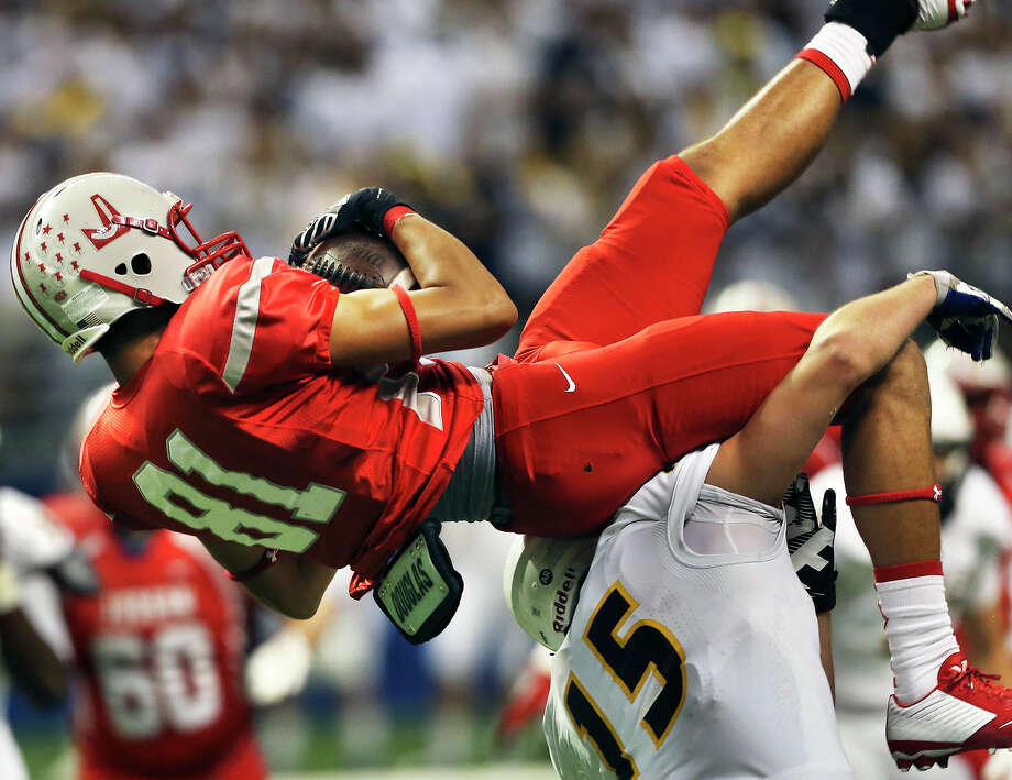 Rocket receiver Gabriel Lopez comes down with a pass over Bryce Saracene in the first quarter as Judson hosts Cypress Ranch in 6A Division I semifinal action at the Alamodome on December 13, 2014. Photo: TOM REEL, By Tom Reel/Express-News