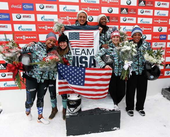 United States women's bobsled members celebrate winning the top three spot in the women's bobsled World Cup on Saturday, Dec. 13, 2014, in Lake Placid, N.Y. From left are second-place finishers Jazmine Fenlator Natalie Deratt, winners Elana Meyers Taylor and Cherrelle Garrett, center, and Jamie Greubel Poser and Lauren Gibbs. (AP Photo/Mike Groll)  ORG XMIT: NYMG122 Photo: Mike Groll / AP