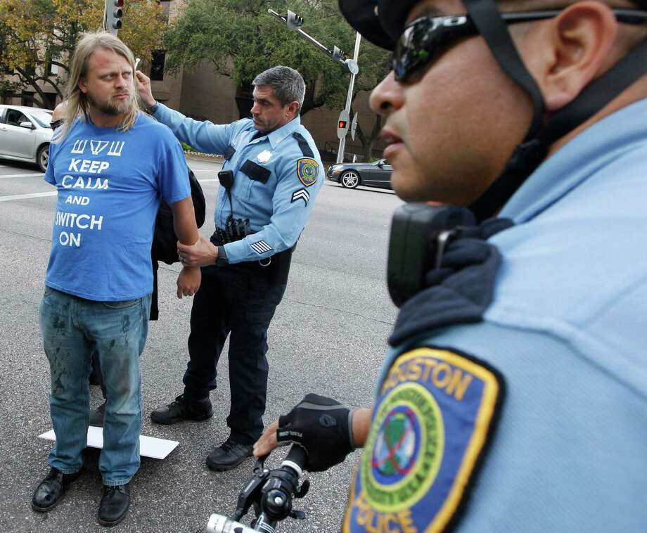 A protester is arrested by Houston police Saturday during a demonstration outside the Galleria   Photo: J. Patric Schneider, Freelance / © 2014 Houston Chronicle