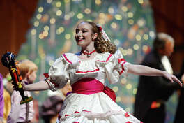 """Bailey Brewton dances as Clara while holding a nutcracker adorned with a Texans helmet during """"The Nutty Nutcracker"""" on Saturday. Beaumont Civic Ballet put on a performance of """"The Nutty Nutcracker"""" at the Julie Rogers Theatre on Saturday night. The ballet was the traditional Christmas performance with addition of surprise modern pop music selections and pop culture references throughout. Photo taken Saturday 12/13/14 Jake Daniels/The Enterprise"""