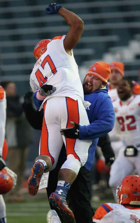 Sam Houston State tight end Josh Lyons and assistant coach Kyle Siegler celebrate the Bearkats' victory over Villanova in the FCS quarterfinals. Photo: Laurence Kesterson, FRE / FR170723 AP
