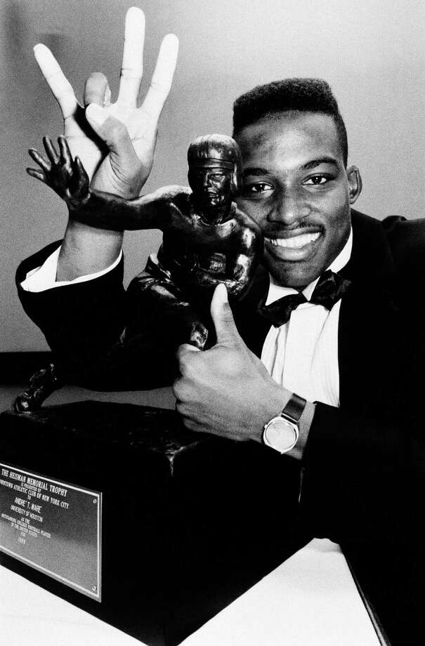 UH's Andre Ware overcame long odds to become the first black quarterback to win the Heisman Trophy in 1989. / 1989 AP
