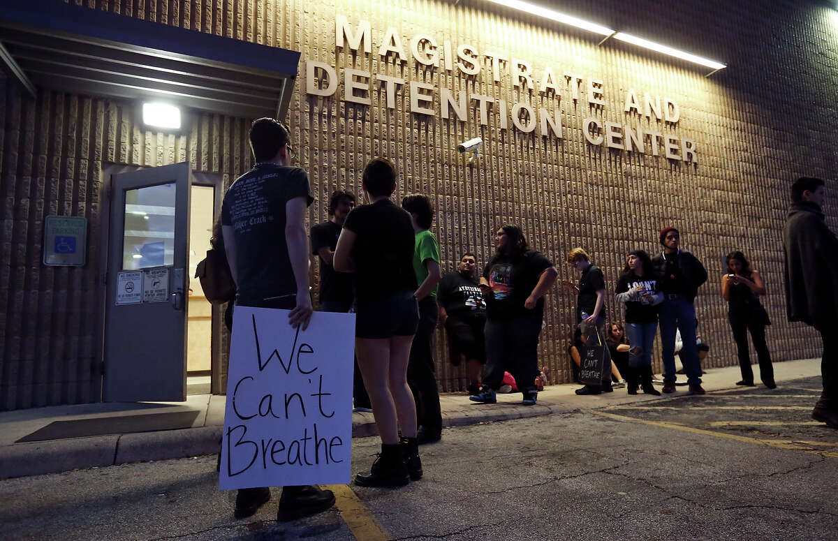 Protesters gather Saturday Dec. 13, 2014 outside the Magistrate and Detention Center after two members from the group SATX4 were arrested near North Star Mall.