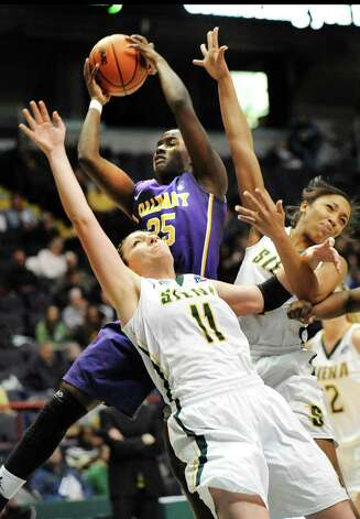 UAlbany's Shereesha Richards, top, grabs the rebound as Siena's Margot Hetzke, left, and Emia Willingham defend during their basketball game on Saturday Dec. 13, 2014, at Times Union Center in Albany, N.Y. (Cindy Schultz / Times Union) Photo: Cindy Schultz / 00029815A