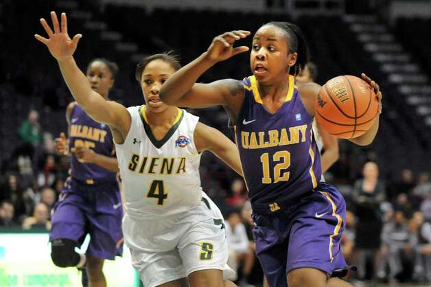 UAlbany's Imani Tate, left, controls the ball as Siena's Emia Willingham defends during their basketball game on Saturday Dec. 13, 2014, at Times Union Center in Albany, N.Y. (Cindy Schultz / Times Union) Photo: Cindy Schultz / 00029815A
