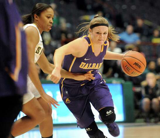 UAlbany's Sarah Royals, right, controls the ball as Siena's Emia Willingham defends during their basketball game on Saturday Dec. 13, 2014, at Times Union Center in Albany, N.Y. (Cindy Schultz / Times Union) Photo: Cindy Schultz / 00029815A