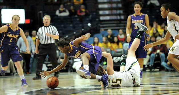 UAlbany's Zakiya Saunders, center, gets fouled on by Siena's Meghan Donohue during their basketball game on Saturday Dec. 13, 2014, at Times Union Center in Albany, N.Y. (Cindy Schultz / Times Union) Photo: Cindy Schultz / 00029815A