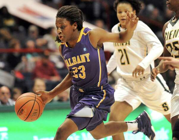 UAlbany's Zakiya Saunders, left, drives up court during their basketball game against Siena on Saturday Dec. 13, 2014, at Times Union Center in Albany, N.Y. (Cindy Schultz / Times Union) Photo: Cindy Schultz / 00029815A
