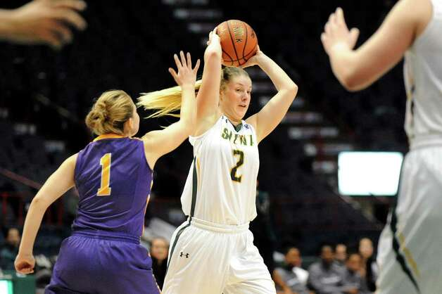 Siena's Ida Krogh right, looks to pass as UAlbany's Erin Coughlin defends during their basketball game on Saturday Dec. 13, 2014, at Times Union Center in Albany, N.Y. (Cindy Schultz / Times Union) Photo: Cindy Schultz / 00029815A