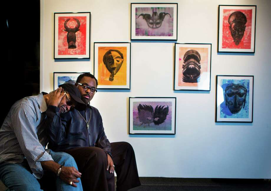 Ezra Roy, 26, holds Alvin Roy who has been not only his parent but also his art teacher and mutual source of inspiration.  Photo: Marie D. De Jesus, Staff / © 2014 Houston Chronicle