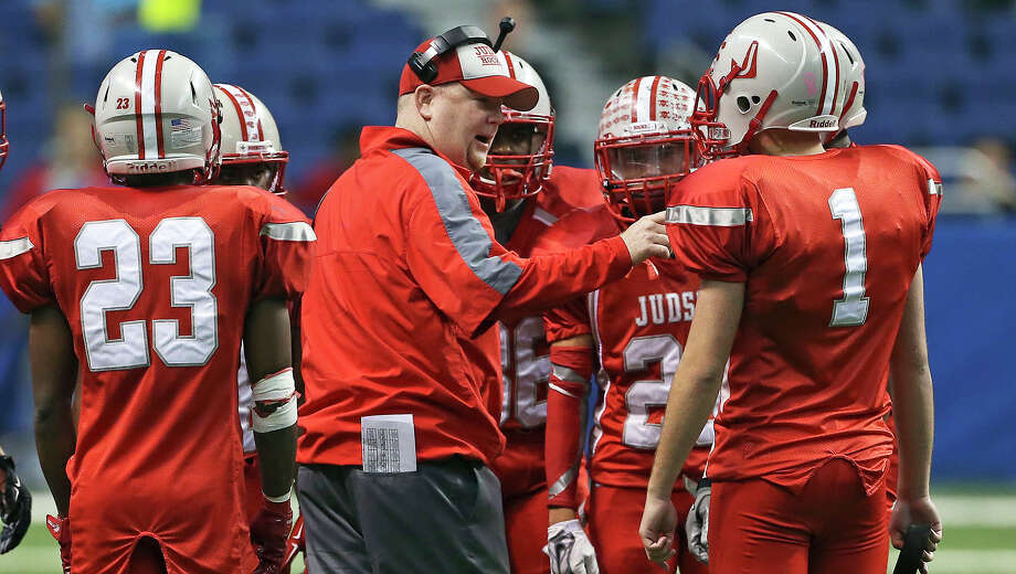 Rockets head coach Sean McAuliffe gathers his players during a time out as Judson hosts Cypress Ranch in 6A Division I semifinal action at the Alamodome on Dec. 13, 2014. Photo: Tom Reel /San Antonio Express-News / San Antonio Express-News